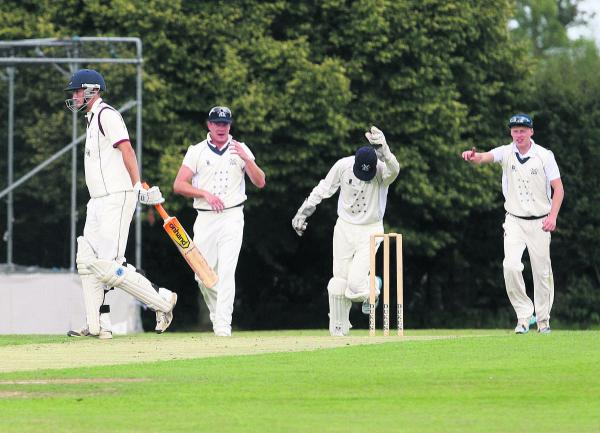 Aston Rowant wicket-keeper Dan Matthews leads the celebrations after taking the catch to dismiss Banbury opener Lloyd Sabin, who starts the long walk back to the pavilion