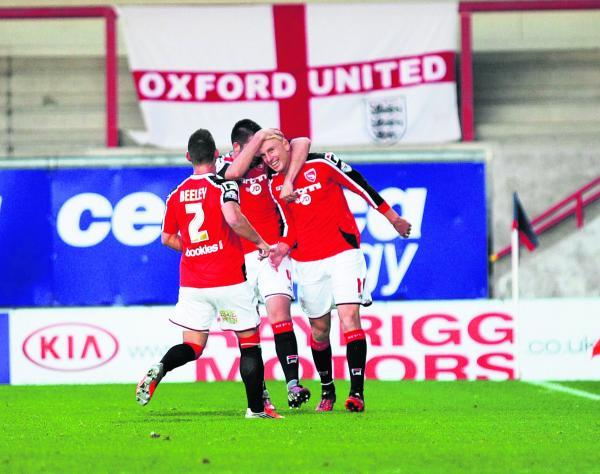 Kevin Ellison (right) is congratulated on his winning goal