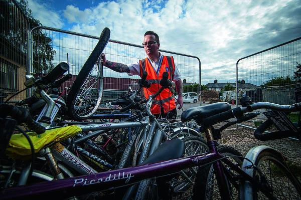 WHEELS: Andy Proper, Street Scene supervisor, in the bike compound of Florence Park, Cowley