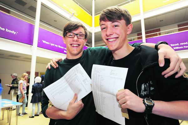 identical twins Ben, left, and Lewis Thorne, who got identical grades at Oxford Spires Academy