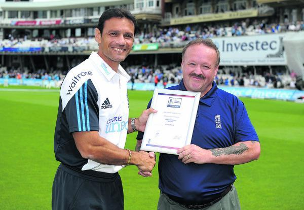 Martyn Cross receives his award from ex-England batsman Mark Ramprakash