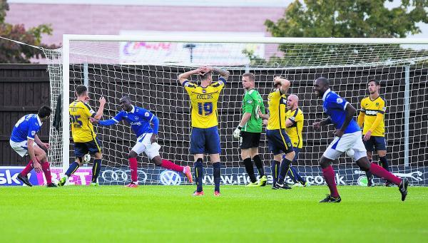 Oxford United's players cannot believe it as Craig Westcarr (third from left) wins it for Portsmouth