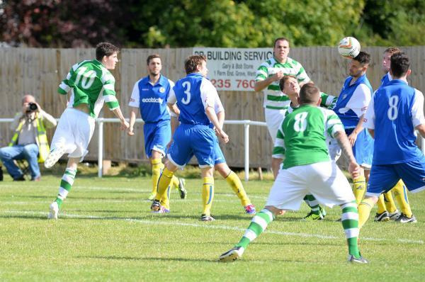 Wantage's Karl Roberts (No 10) heads home powerfully at the start of the second half