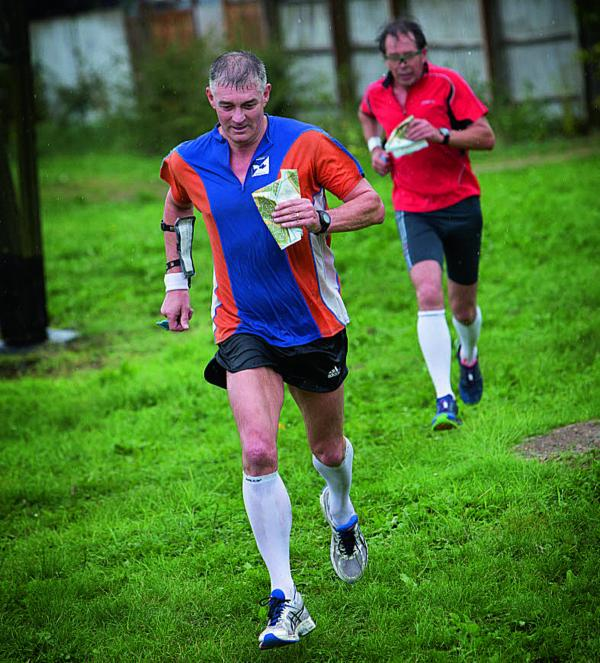 Derick Mercer, left, and Pete Jones race to the finish line in the urban orienteering event in Didcot     Pictures: OX69414 Damian Halliwell