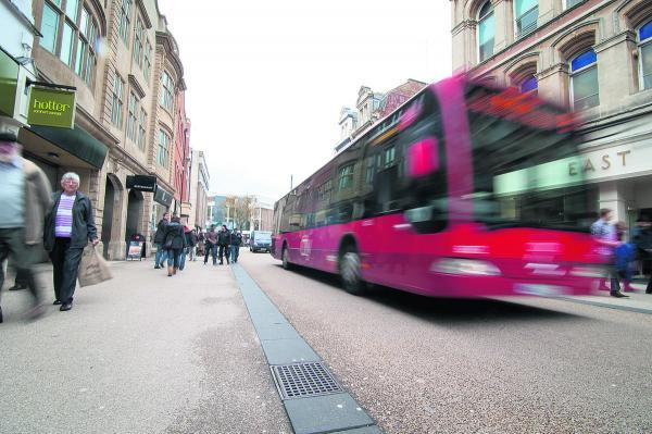 Queen Street has a mixture of pedestrians and a limited number of buses