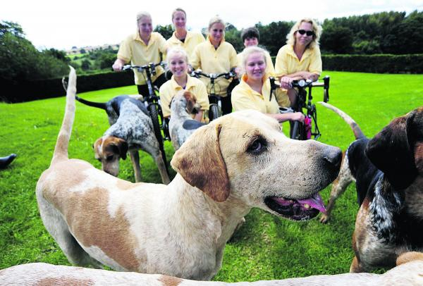 With the hounds, from back left, Honor Barker, Sophie Gannon, Nicki Williams, Henry Barker and Lisa Cartlidge, with Camilla and Lizzie Coombes in the front row