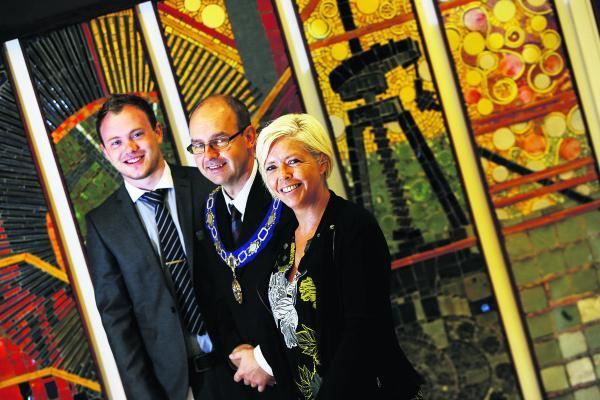STRIKING: Civic Hall manager Rachael Spindler and deputy manager John Shuttler, left, with Didcot mayor Scott Wilgove, centre