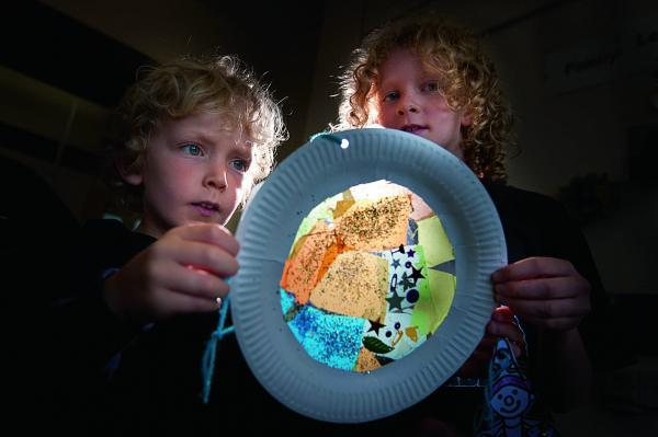 Max and Josie Hutchings with their paper 'stained glass window'