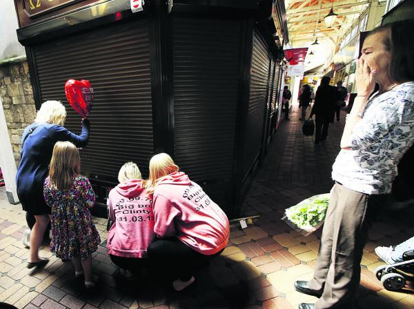 Members of Townsend's family at the scene in the Covered Market