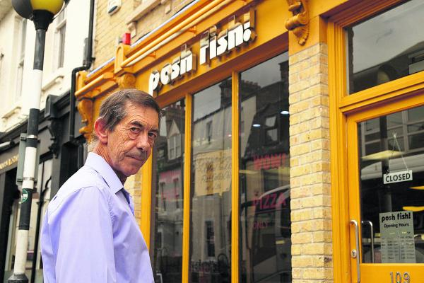 Auctioneer Tony Flynn outside Posh Fish in Walton Street  Pictures: OX69523 Greg Blatchford