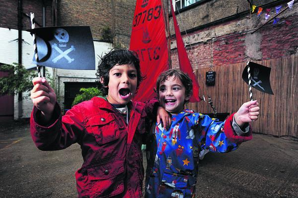 Pirates Leo Robinson-Po, left, and Laurie Potts, both four, with their flags