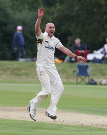 Oxfordshire's Chad Keegan celebrates trapping Devon's Trevor Anning lbw