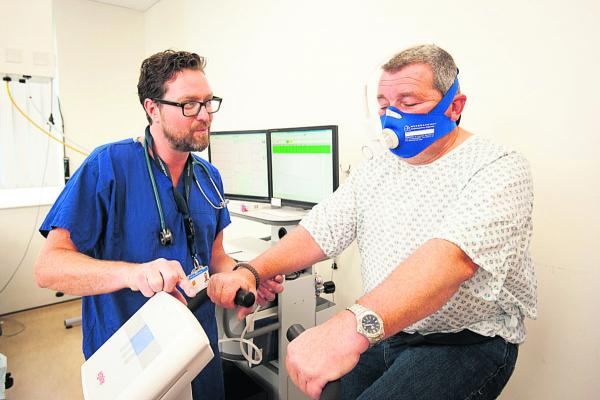 Consultant anaesthetist Dr John Griffiths takes patient Andrew Binks through a Cardiopulmonary Exercise Test
