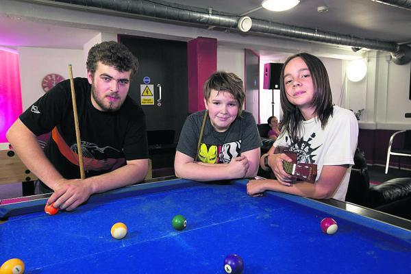 From left, Adam Leen, 17, Fraser Rennard, 13, and Callum Harris, 14, at Autism Family Support. Pictures: OX69519 Damian Hal