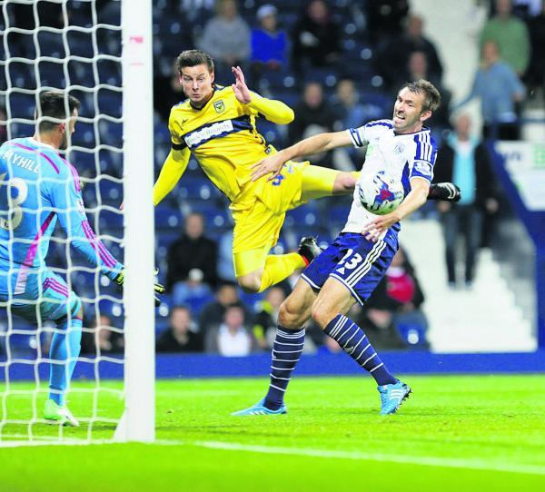 Will Hoskins heads back across goal for Danny Hylton to score just minutes after making his Oxford United debut at West Brom on Tuesday night       Picture: Damian Halliwell Order no: OX69443