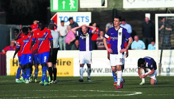 Josh Ruffels (right) reflects on the freak own goal as Dagenham's players celebrate