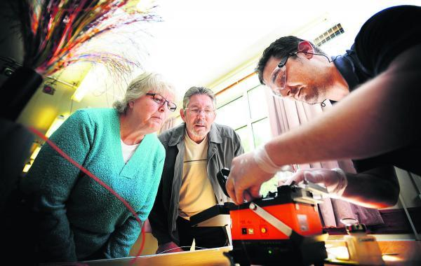 Karl Rolfe demonstrates the technology to Elaine and Derek Baker at Weston-on-the-Green, near Bicester becomes the latest rural community to get high-speed broadband