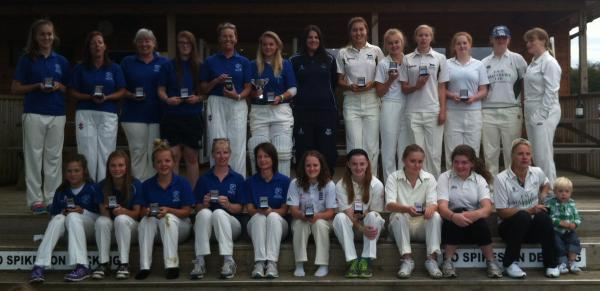 Oxfordshire Midweek Women's League champions Freeland (blue shirts) line up with runners-up Shipton-under-Wychwood at Charlbury and Sussex CC director of women's and girls' cricket Charlotte Burton (back row, centre), who presented the medals and tr