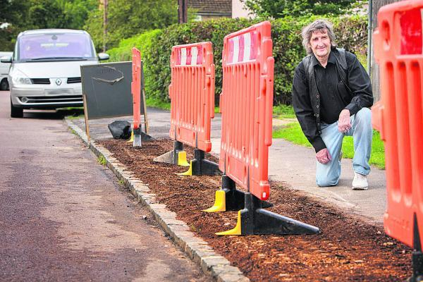 City councillor Mick Haines in Rippington Drive, Marston, where hard-standing grids are being laid to protect the verges from damage caused by cars parking on them