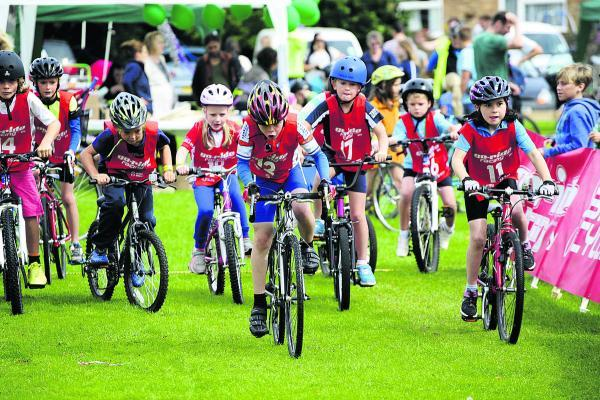 Youngsters charge away from the start line in one of the fun day's bike races