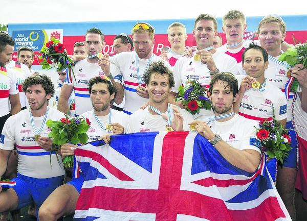 Great Britain's men's eight celebrate their World Championship win in Amsterdam