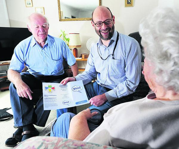 From left, Abingdon Good Neighbours Scheme chairman David Harmsworth and volunteer Michael Kovari with an elderly neighbour he visits Picture: OX69568 Jon Lewis