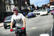 Paul Wolf, seen cycling in Cowley Road, is already thinking about next summer's carnival     Picture: OX69599 Ed Nix