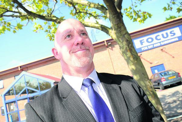 B&M Bargains store manager Alan Feeney outside the old Focus store it is to replace