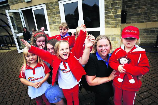 Group leaders Louise Kinchin, left, and Kellly Hale with the girls from the 3rd Witney Rainbows