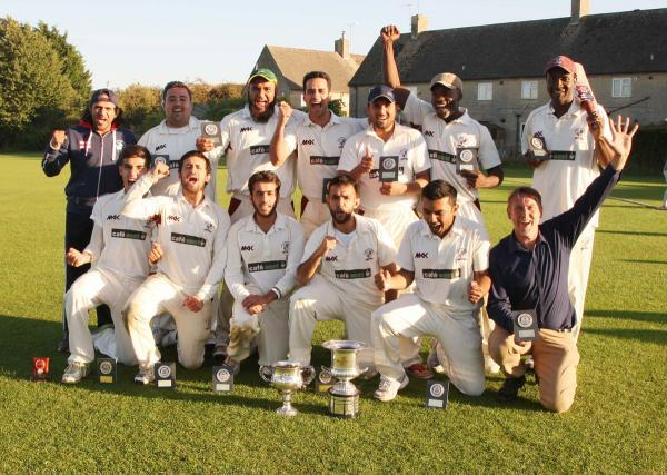Cowley Internationals players celebrate their victory over Great Horwood