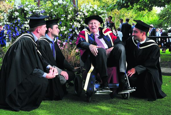 Sir Roger Bannister with Oxford Brookes University students, from left, Gareth Wilson, Chris Moy and James Daniel, who all graduated with a foundation degree in paramedic emergency care from the faculty of Health and Life sciences