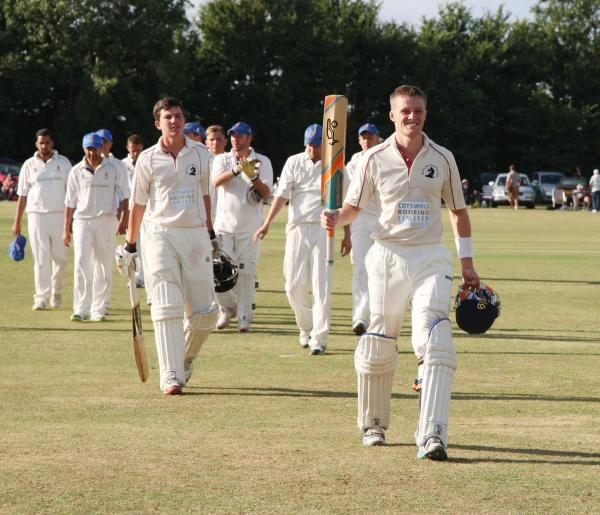 Ashley Hubbert (right) takes the applause after he and Jordan Garrett (left) steered Great & Little Tew to a nine-wicket victory at Dinton in the semi-final