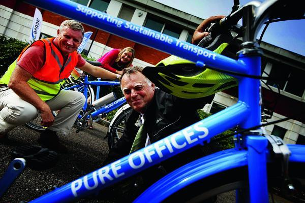 Oxford East MP Andrew Smith at the sustainable transport roadshow in Oxford Business Park, encouraging people to cycle to work. He is pictured with bike builder Stephen Preston and MD of Pure O