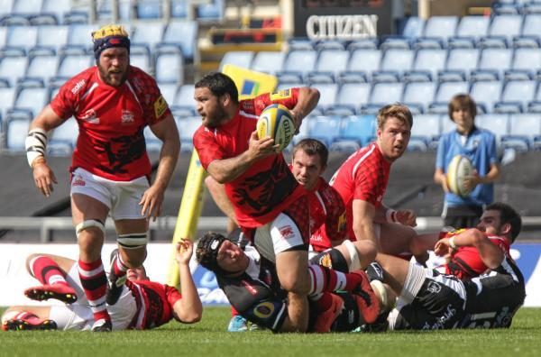 London Welsh debutant Piri Weepu looks to get the ball away before being tackled by Exeter's two-try No 8 Thomas Waldrom during his side's 52-0 defeat at the Kassam Stadium. Picture: Andy Fitzpatrick