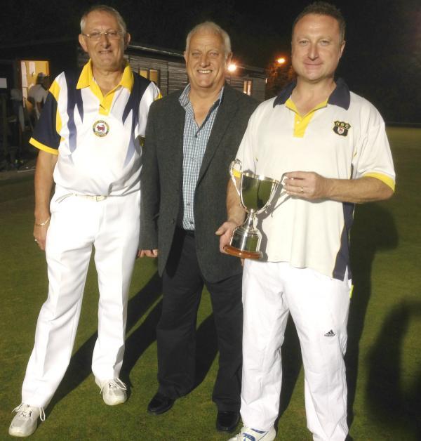 Oxford City & County A captain Paul Comley (left), sponsor Sammy Timms (centre) and Headington A captain Mark Charlett with the trophy