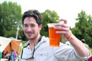 Fete organiser Olly Wills enjoys a beer