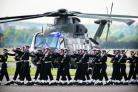 In step: 846 Naval Air Squadron march in front of a Merlin helicopter at the handover