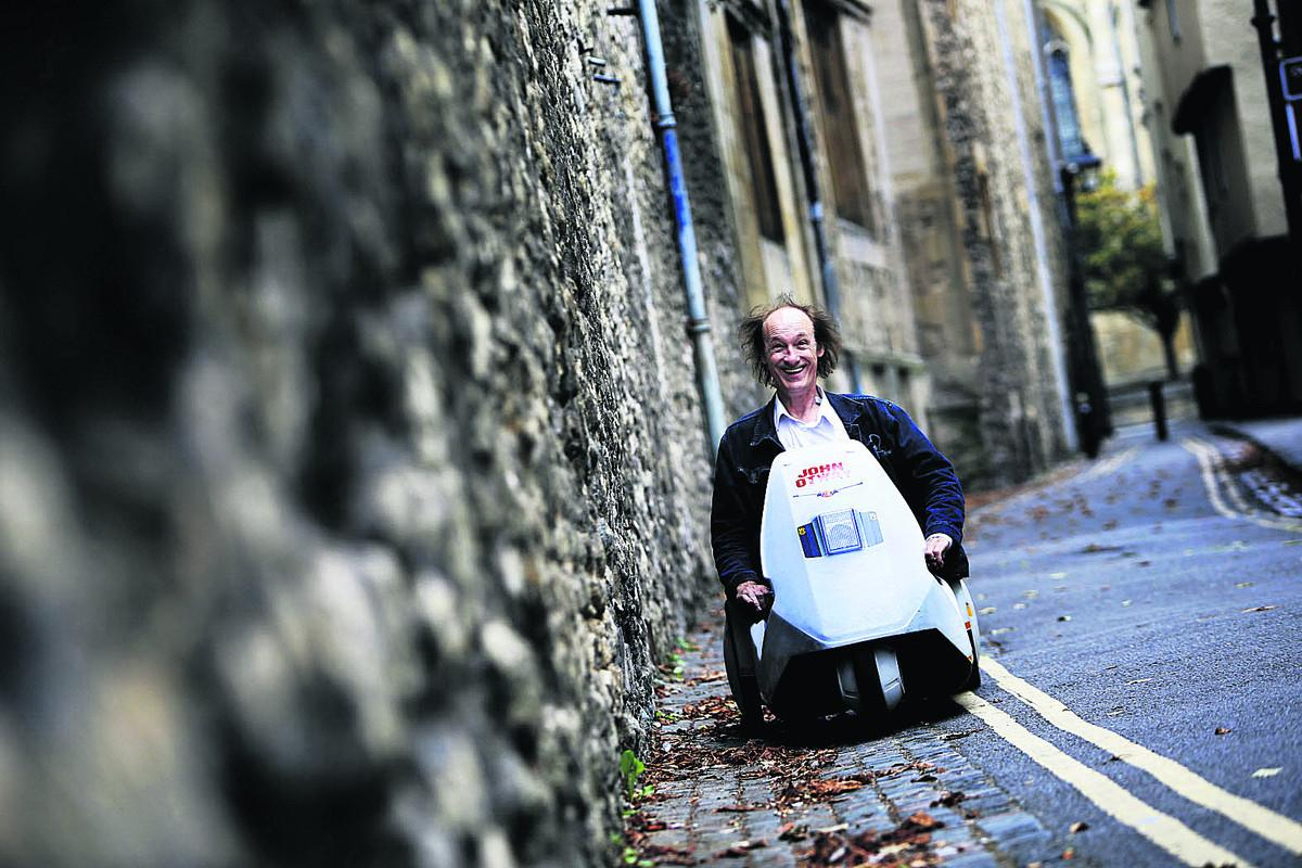 John Otway makes his way around the city in a Sinclair C5. .Picture: OX70374 Ed Nix
