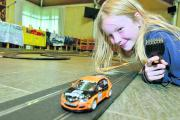 Caitlin James, eight, taking part in the Scalextric Challenge