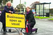 County councillors Roz Smith, left, and Glynis Phillips, pictured in the service road alongside the A40 at Risinghurst