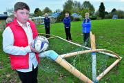Pupils from Tower Hill School in Witney, with one of the three goal posts that have been vandalised. From left are 10-year-olds Quinn Savage, Regan Pritchard, William May and Patrick Walsh