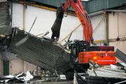 A 47-tonne excavator shears off the roof of the former Halfords and MFI store in Botley Road