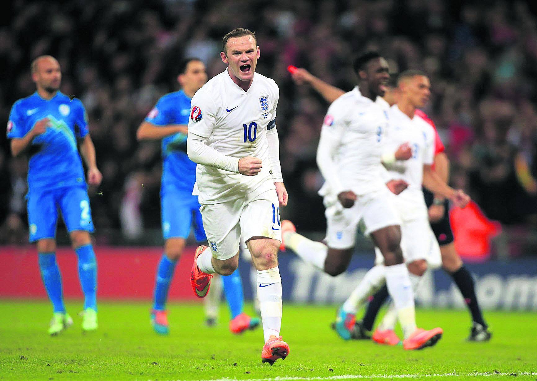 Wayne Rooney celebrates scoring against Slovenia on Saturday, his 44th goal for England