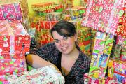 Volunteer Becki Reed with a collection of shoeboxes for Operation Christmas Child at High Street Methodist Church in Witney