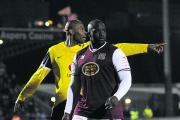 Former United defender and now Oxford Mail columnist Michael Duberry marks Adebayo Akinfenwa during his Northampton Town days. Akinfenwa didn't score, but the U's lost 2-1