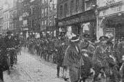 A soldier from The Queen's Own Oxfordshire Hussars says goodbye to his wife and son in Queen Street in 1915