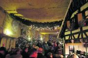 Huge crowds at Valkenburg for the five-week-long Christmas market which takes place inside the town's caves
