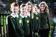 Windmill Primary School headteacher Lynn Knapp with pupils, from left, Daniel Wilcox, Katie Ham, Anna Grunewald and Lewis Cox.      Picture: OX71645 Julian Rus