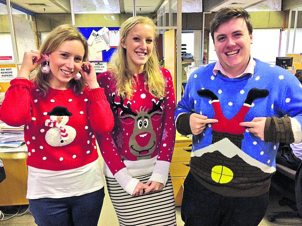 Keeley Rogers, Naomi Herring and Luke Sproule with festive knitwear
