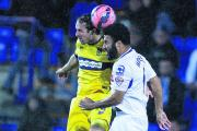 Danny Hylton goes up for the ball with Tranmere Rovers defender Marcus Holness on Tuesday, a game which stretched his wait for a goal to six games    Picture: James Williamson